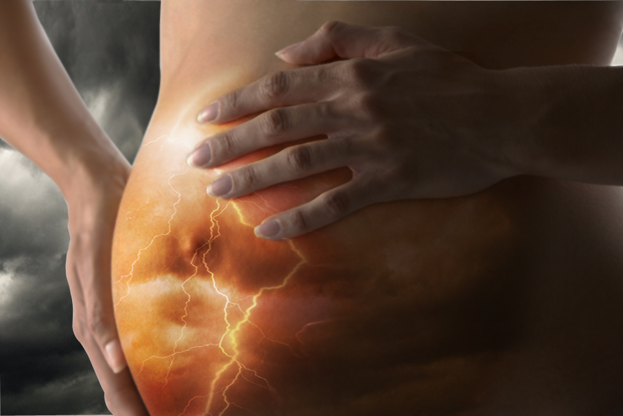 Detail Of Pregnant Woman Holding Stomach